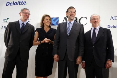 Rodrigo Rato (till höger) tillsattes på posten som ordförande i Bankia av PP-ledaren Mariano Rajoy.
