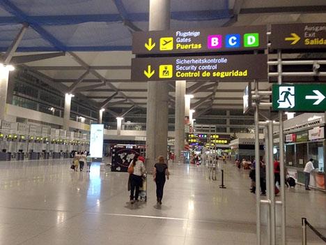 En passagerare på väg hem från Costa del Sol till England skickade två poliser till sjukhus.